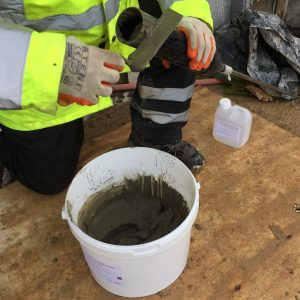 The grout is loaded into a grout mortar gun ready for crack stitching